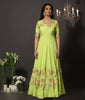 Lime green cold shoulder floral gown in cotton silk with hancrafted resham embroidery. The flowers are highlighted using golden cut-dana and fine pearls.