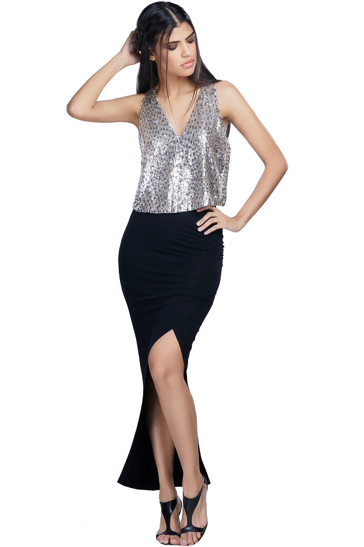 Opt for dangerous and debonair in our sequined top with a cut out at the back.