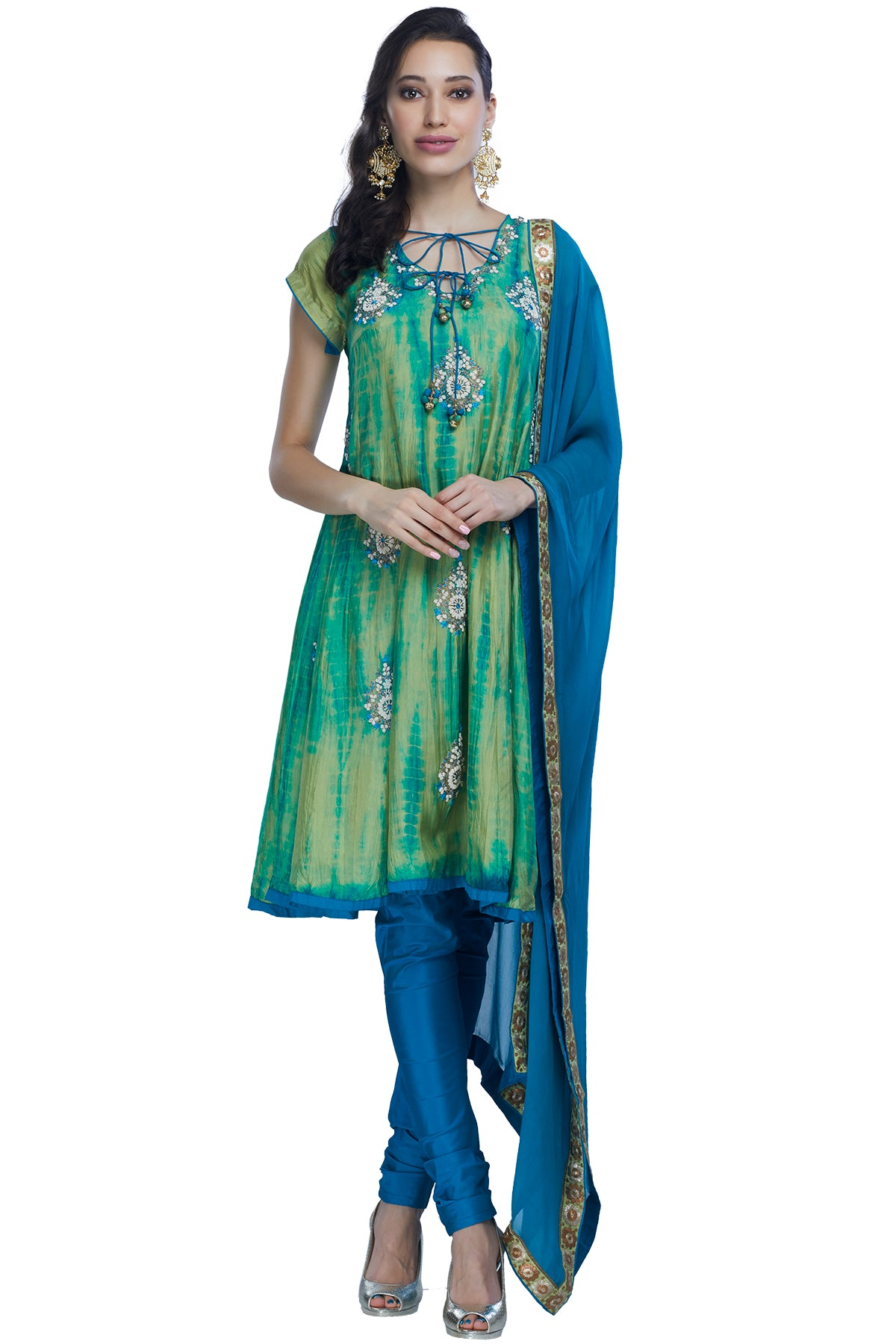 Your new staple for the upcoming festive season, this uplifting kurta churidar in the seizing hues of green and blue can be toned down for a pooja or toned up for a formal event.