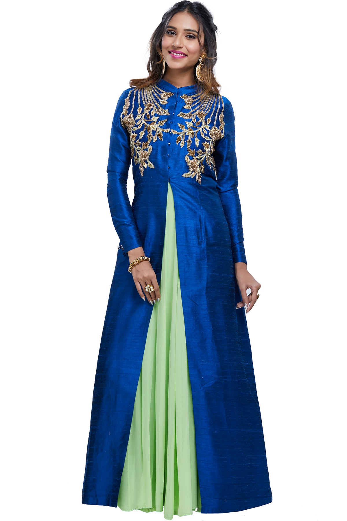 We're talking raw, regal beauty in this piece with its blue full-sleeved raw silk embroidered jacket with zardosi work over a green georgette sleeveless anarkali gown.
