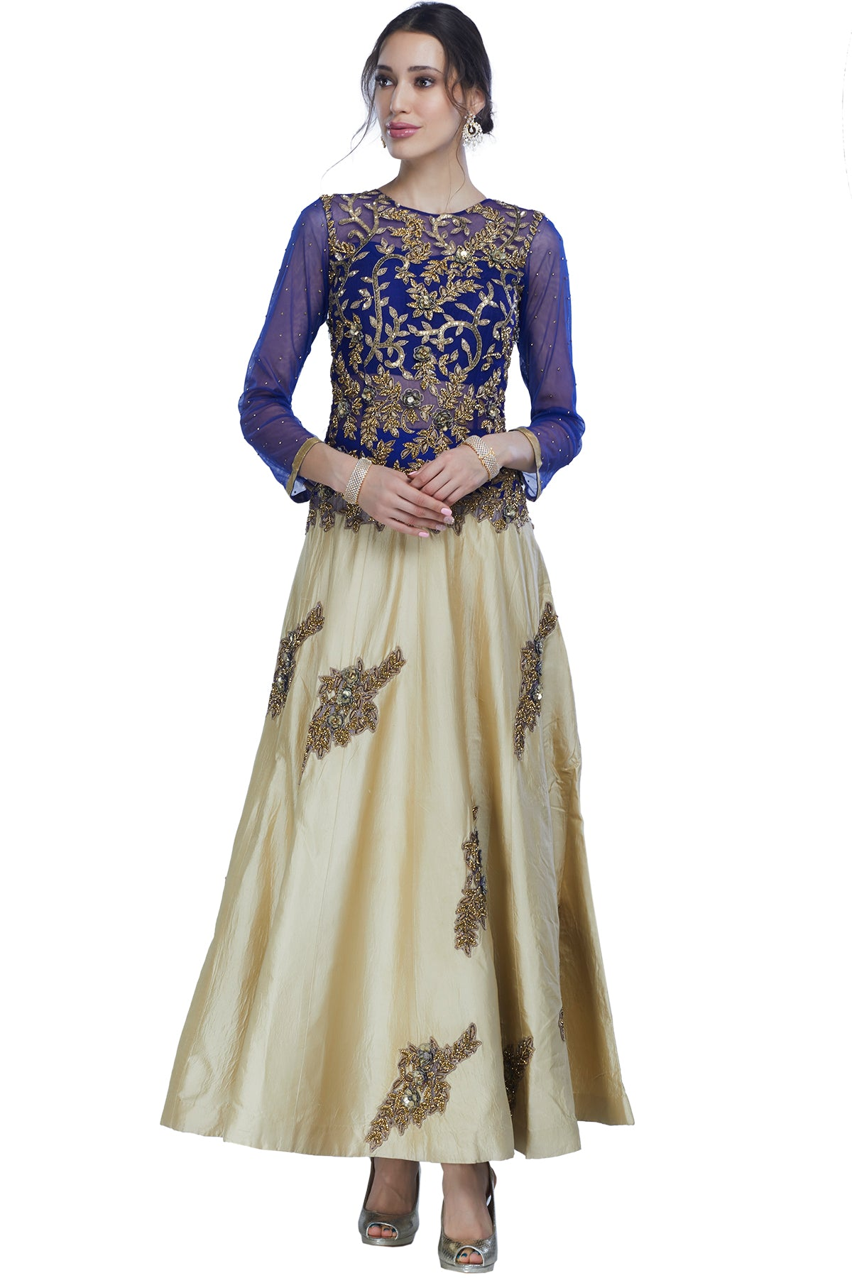 Blue and beige full sleeves indo-western gown with gold embroidery and patchwork sets a bar and makes a statement of its own.