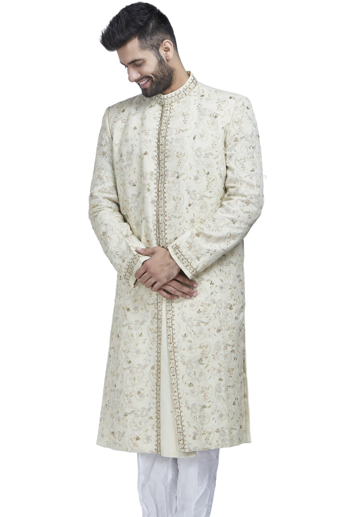 The perfect muse to a palace backdrop or even a gorgeous garden, this ivory sherwani with zari and threadwork is paired with ivory churidars.