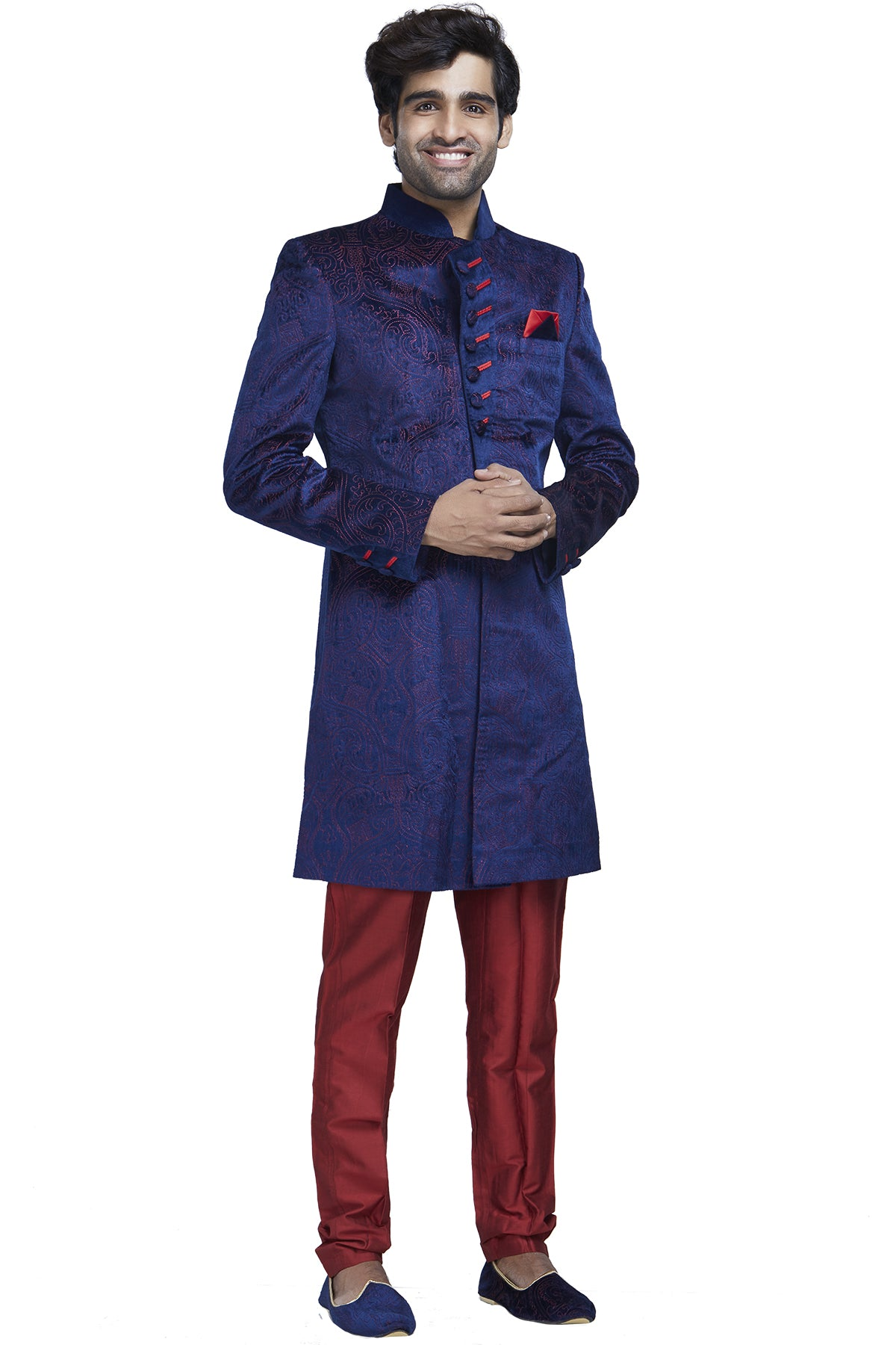 Flaunt the freshest sense of style with this burst of bright complementing colours. Rent out our electric blue textured velvet with red embroidery paired with red slim pants.