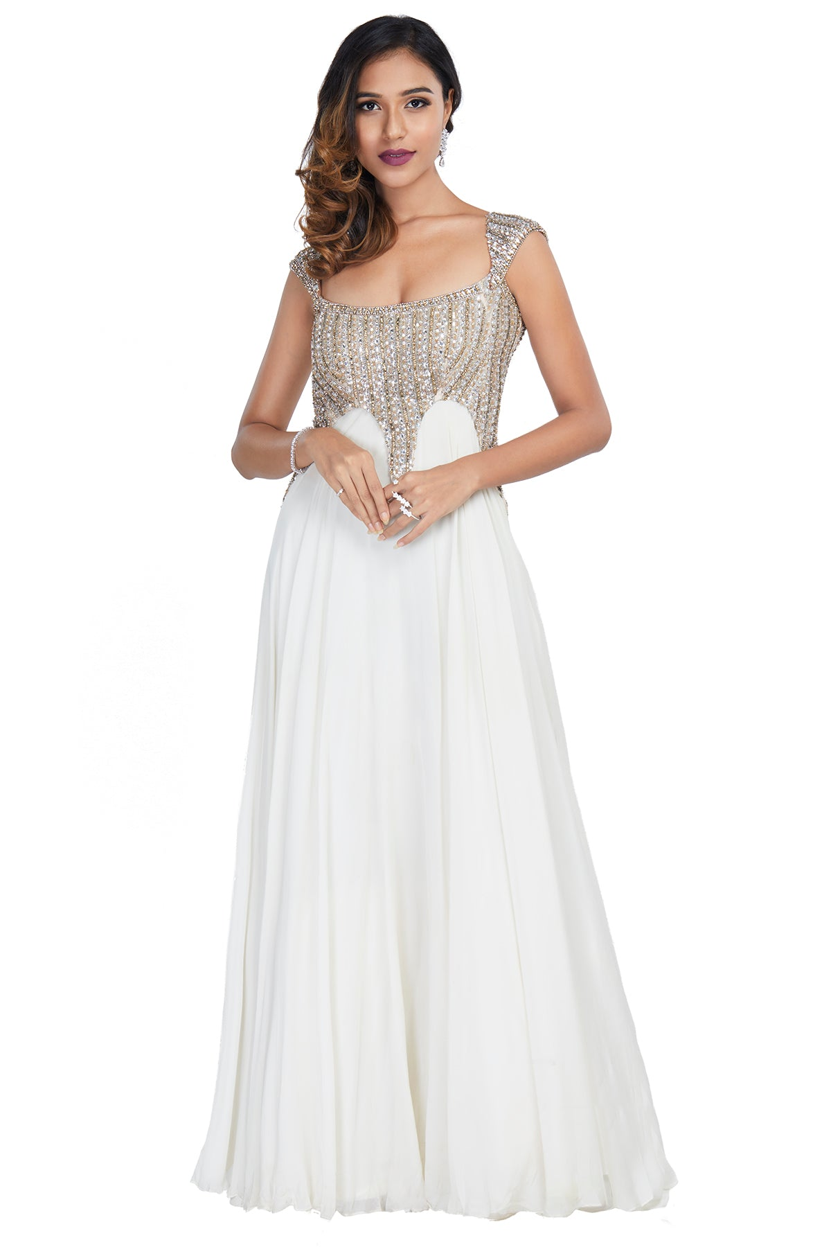 You cannot go unnoticed in this stunning deep neck, gold and white embellished gown with a sexy back!
