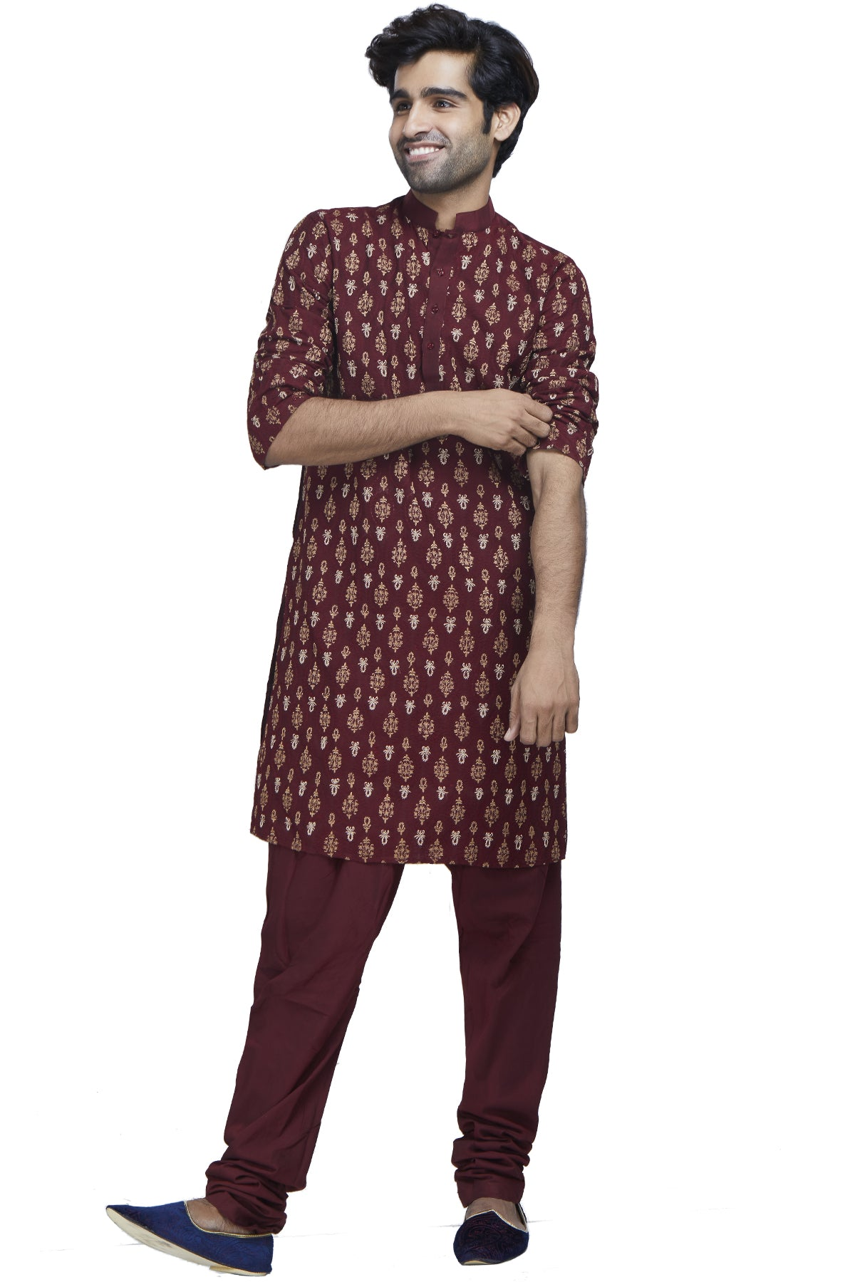 In a seizing blend of texture and rich colour, this maroon georgette kurta with maroon and gold threadwork and zari embroidery is paired with comfortable silk churidars.