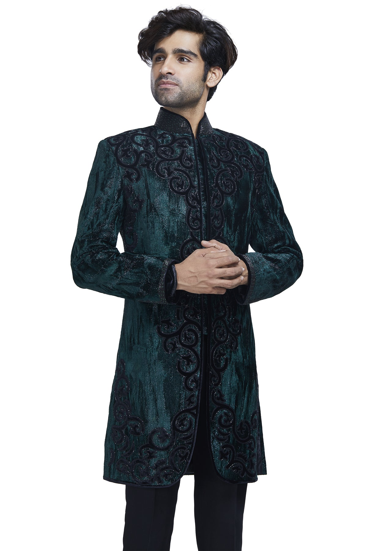 Bringing some dapper swag to any dull day is our green textured sherwani with black threadwork, kardana embroidery and black formal slim pants.