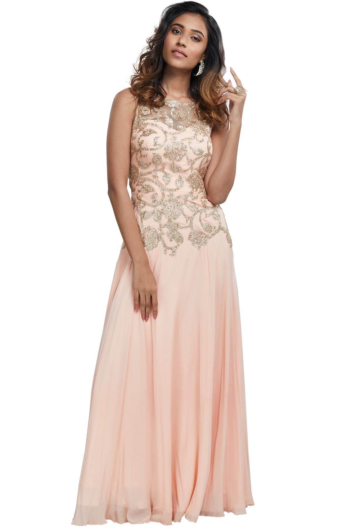 Fly away with your every fantasy in this perfect peach gown with champagne gold glittery embellishments to bring out the bubbly in you.
