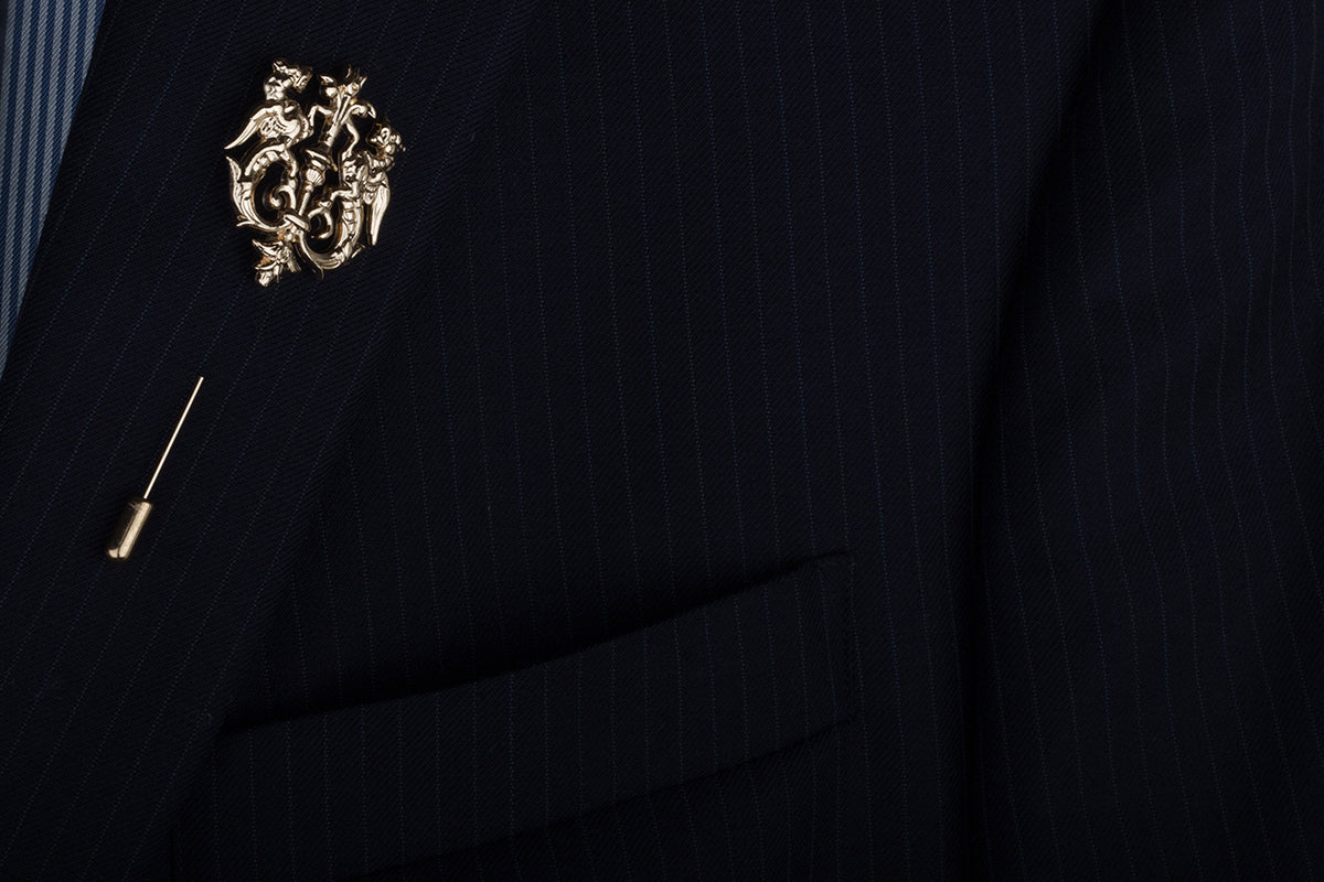 A subtle addition that reeks of regal royalty - this lapel pin is lavishly decorated with an intricate design and spreads the sentiment of sophistication.