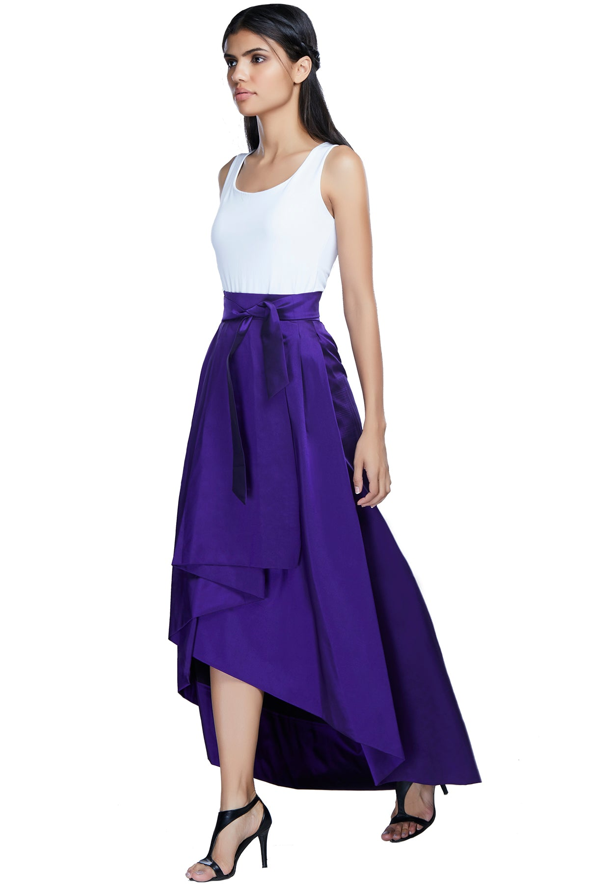 Tease your mood in this sometimes up, sometimes down purple hi-low skirt with a front bow and box pleats.