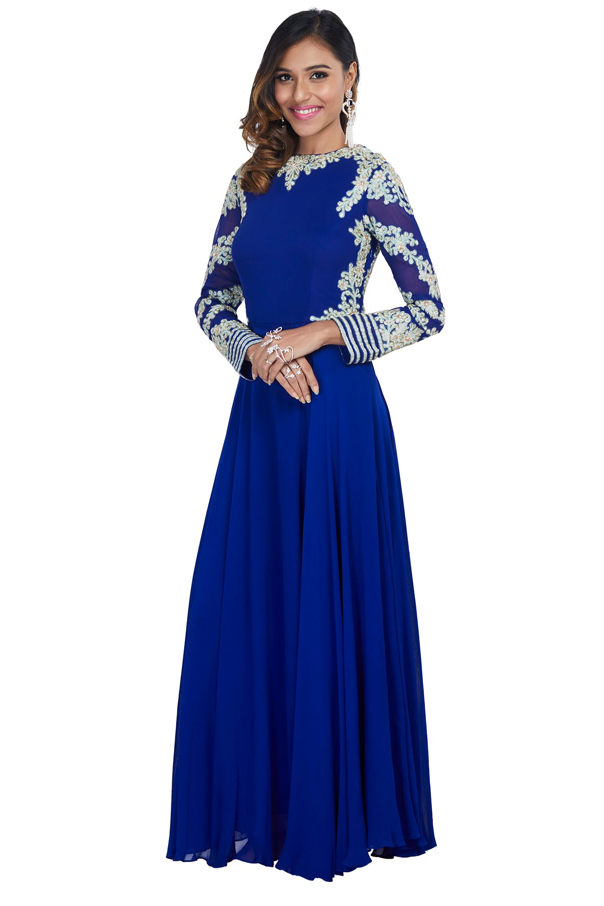 Be the mesmerising vision of majesty in this royal blue georgette gown with a boat neck and fully embroidered sleeves in white & mint green threadwork.