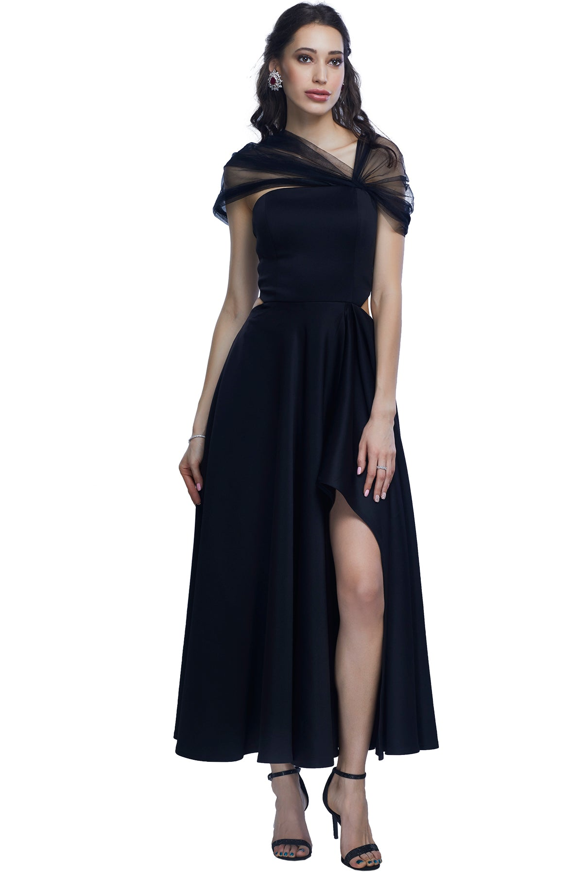 Black gown in scuba fabric with a high front side slit and net off shoulder drape.