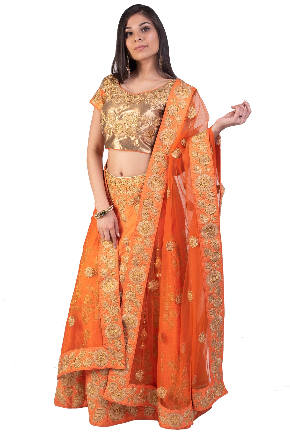 The intricate floral work in zardosi on the orange lehenga is perfect for a mehendi and sangeet function. A show-stopper look, without a doubt.