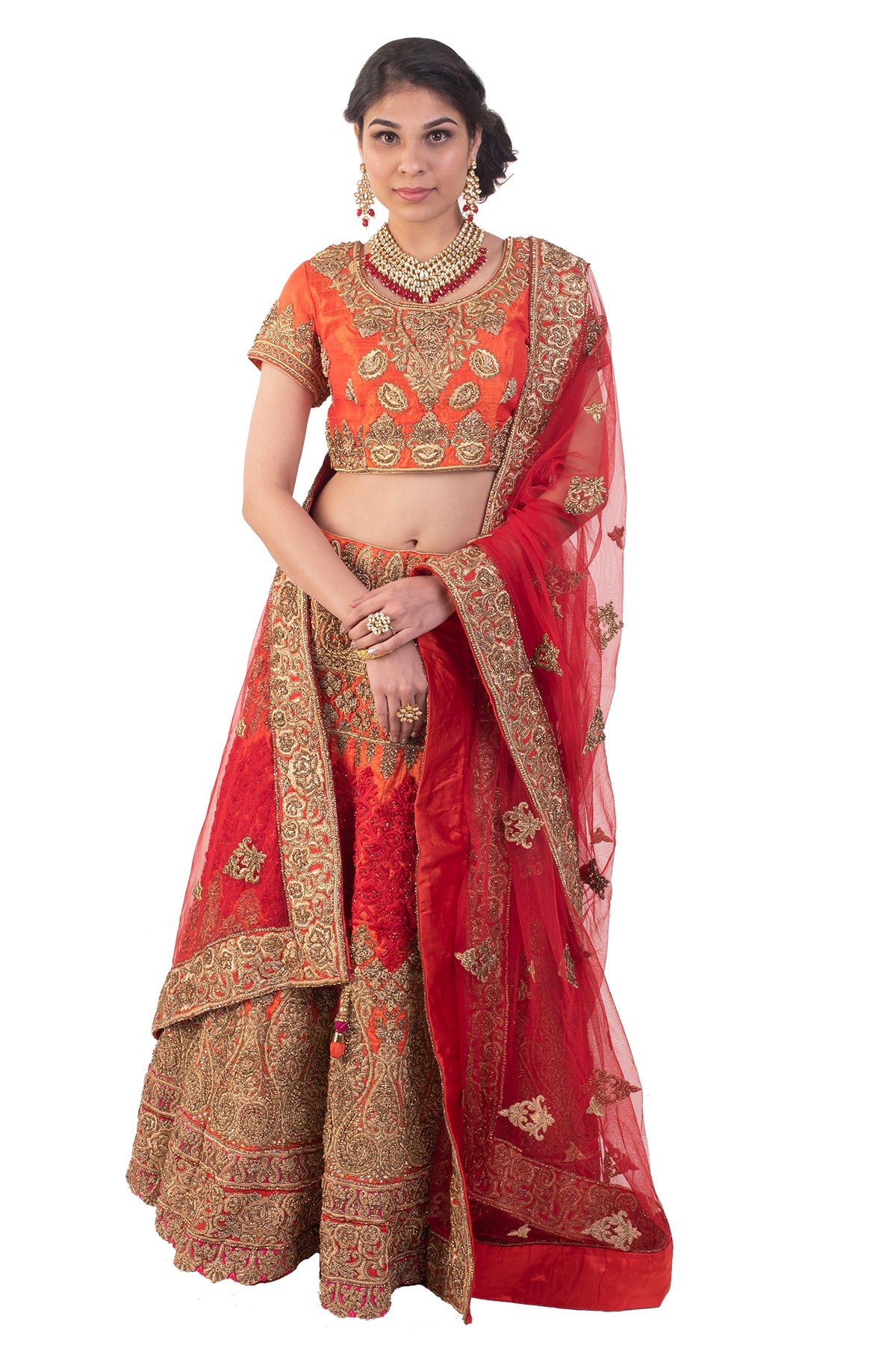 Classical and dazzling is this orange lehenga in traditional zardosi work sprinkled with embellishment and stonework. What more could one ask for!