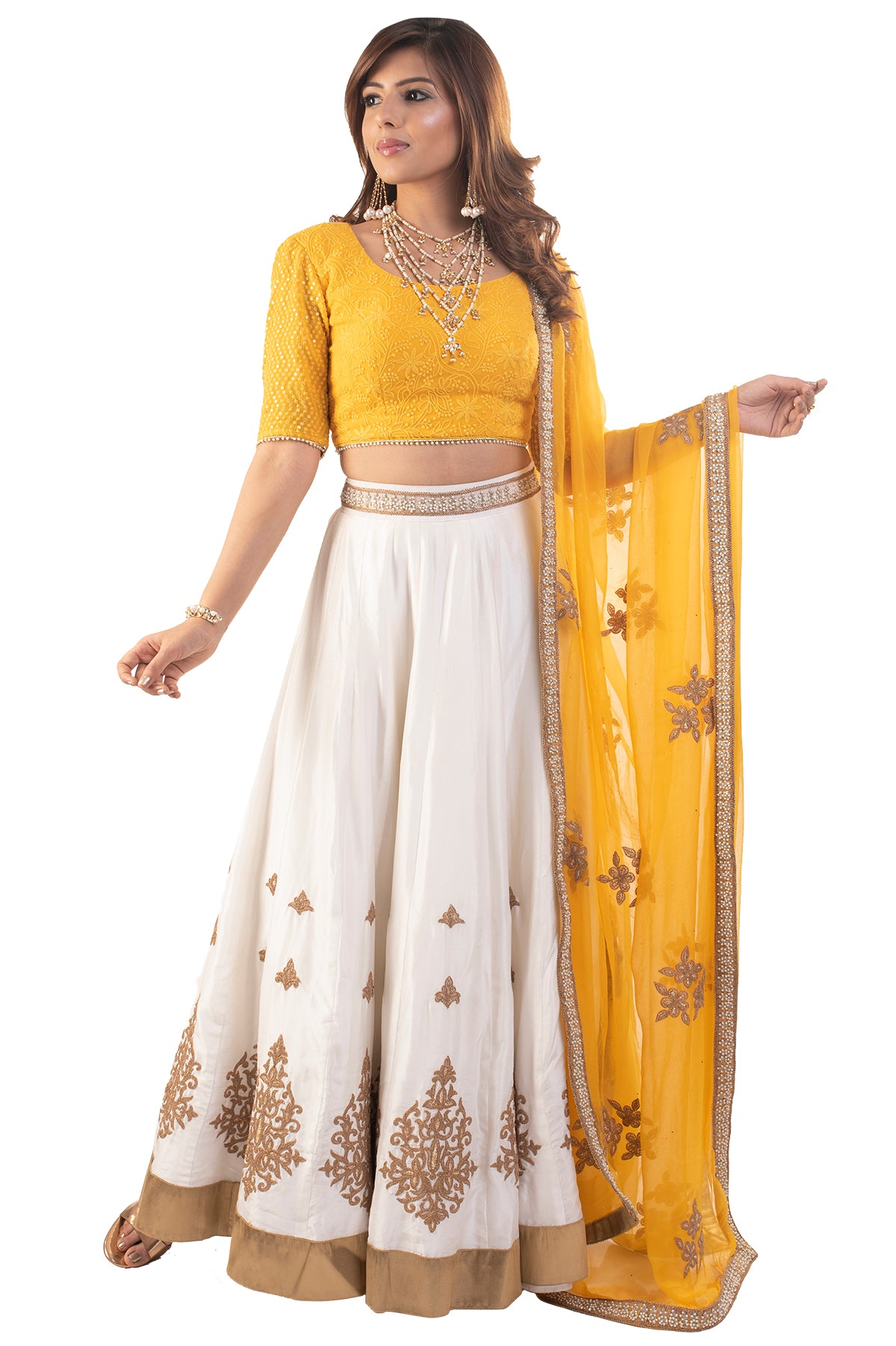 Yellow but not mellow! The bright yellow blouse is just a charmer and more over the white lehenga with a latkan makes it all the more beautiful.