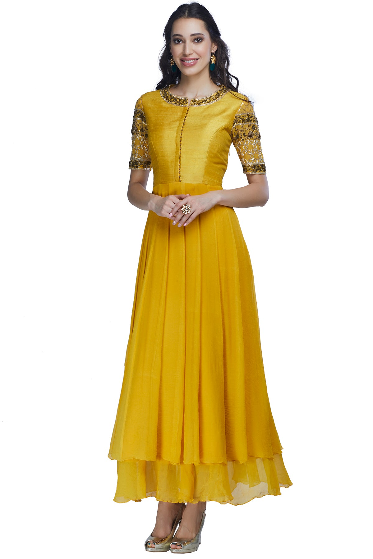 It's time to double the celebrations! This outfit, like a slice of promising sunshine, is turmeric coloured double-layered chiffon anarkali gown with a raw silk body and embroidered chiffon sleeves.