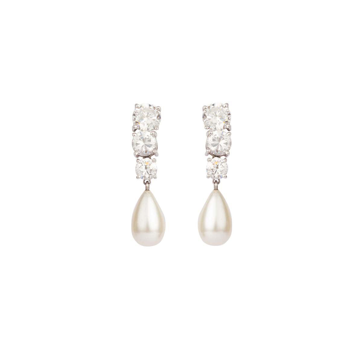 Studded with the shine of a thousand stars, these earrings are made of three solitaires of descending size finished with a perfect pearl drop set in silver.