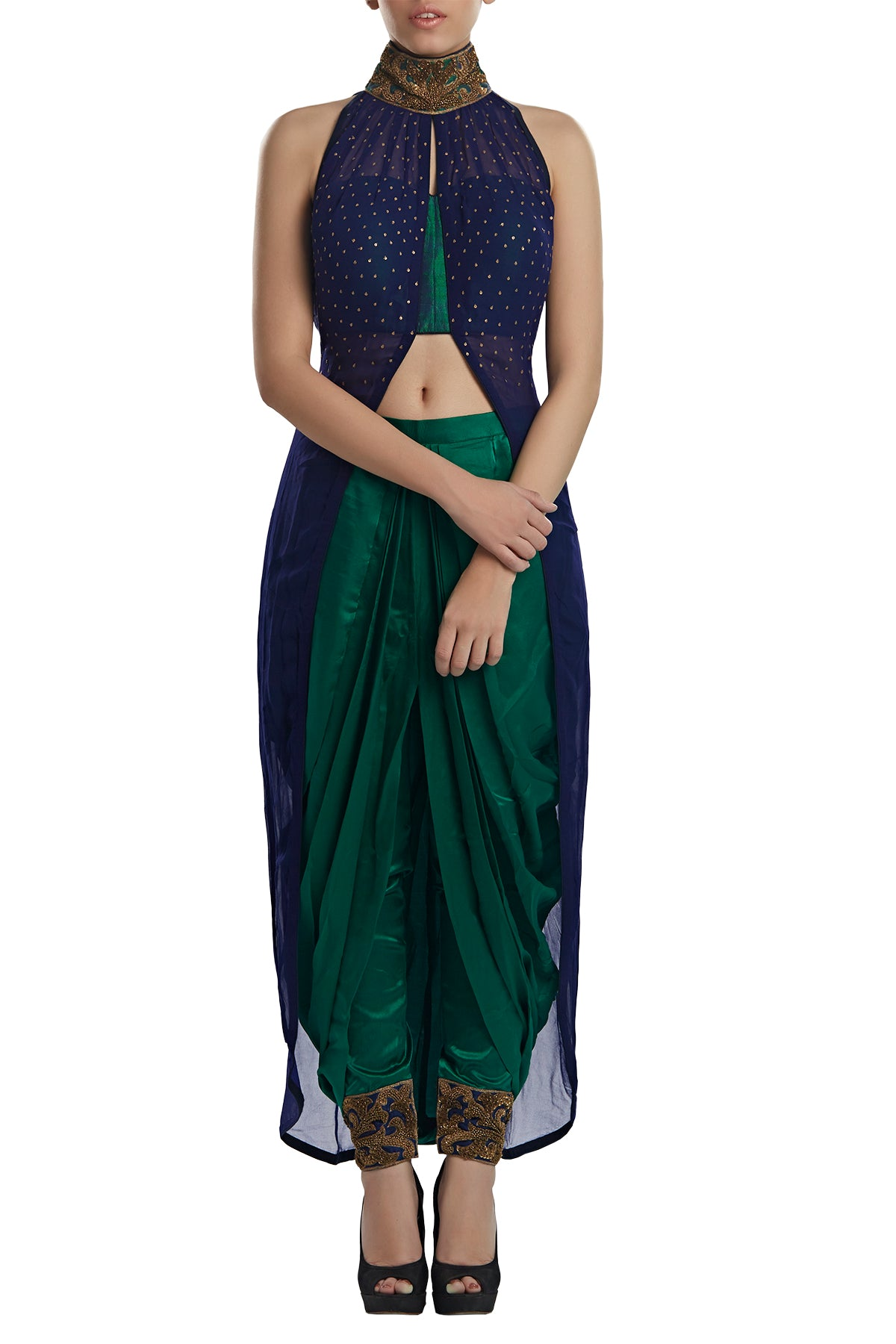 This one's a keeper and should creep into your every wedding suitcase! From welcome dinners to cocktails to evening mehendis when styled right, get your hands on our blue georgette high neck top with satin draped dhoti pants.