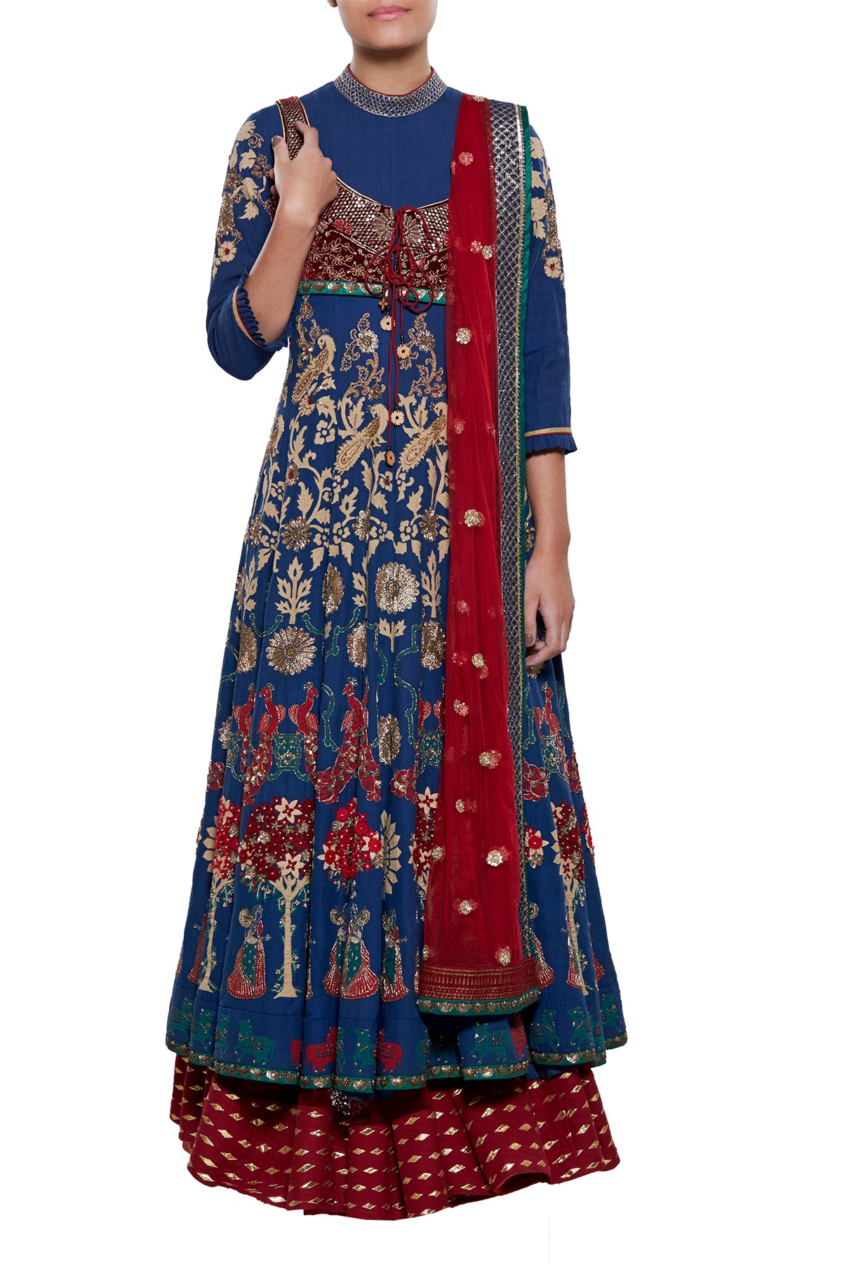 Reeking of royalty in a riveting blue & maroon medley, this gota lehenga skirt in net is paired to perfection with its appliqué blue top. The ensemble is completed with its net embroidered dupatta and short zardosi jacket.