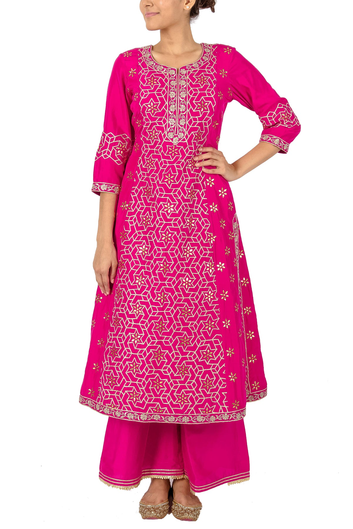 Step into a love triangle and square up your sense of style in this pink suit embroidered with geometric gota patterns. This is paired with embroidery palazzos and a matching dupatta.