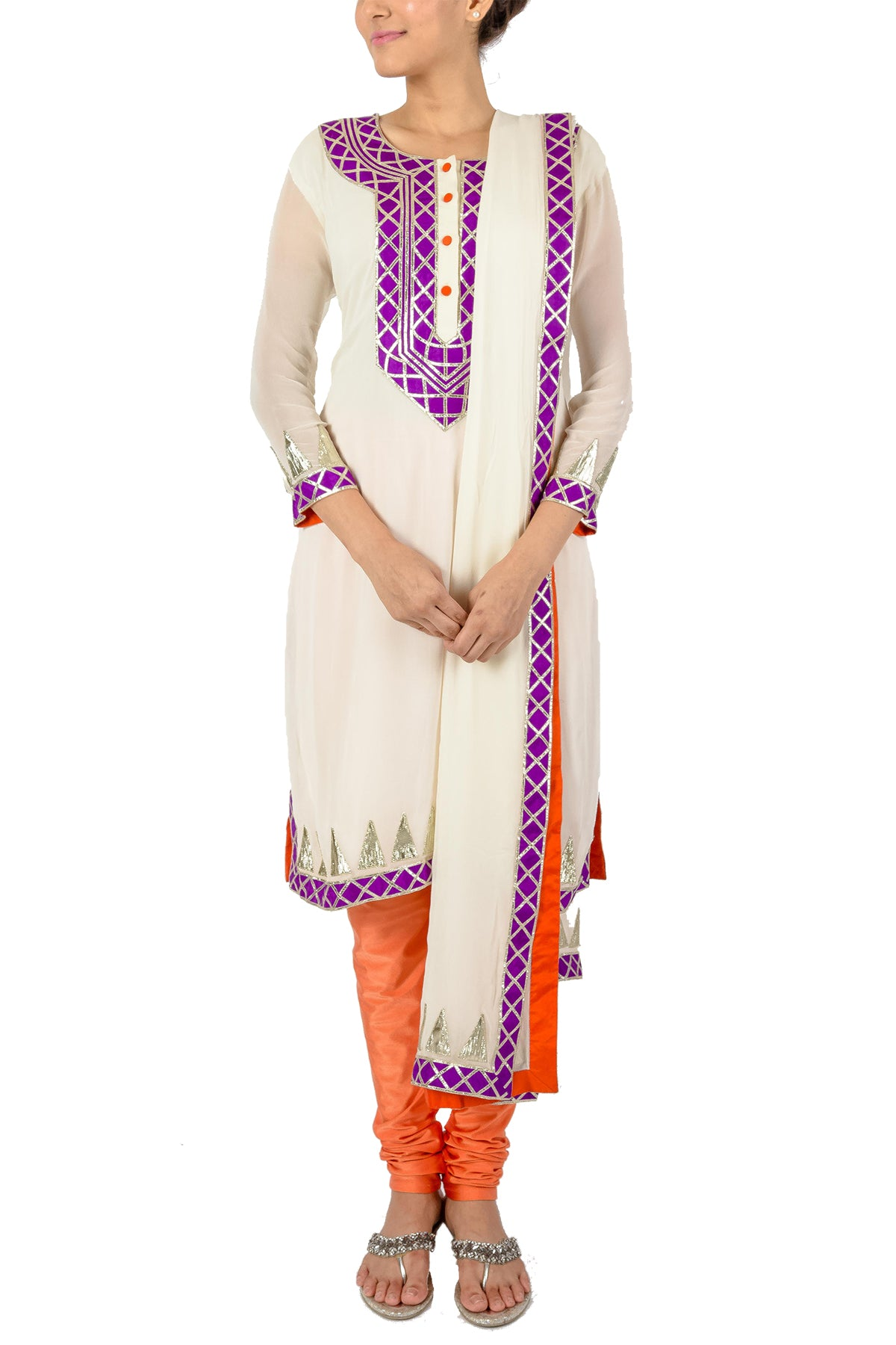 Crafted with utmost art for a pristine heart - this white georgette kurta set is lined with silver gota pati and given a festive edge with purple embroidery and a bright orange churidar.