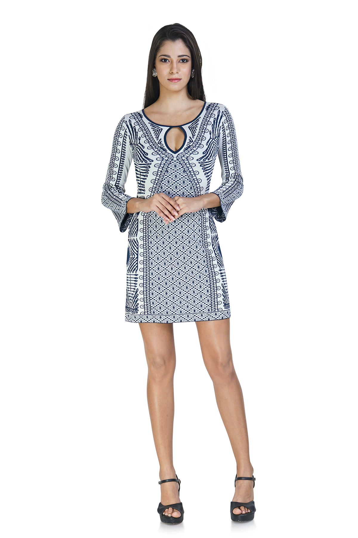 White and blue knit dress with keyhole and printed patterns on both sides fits rightly in both casual and formal category.