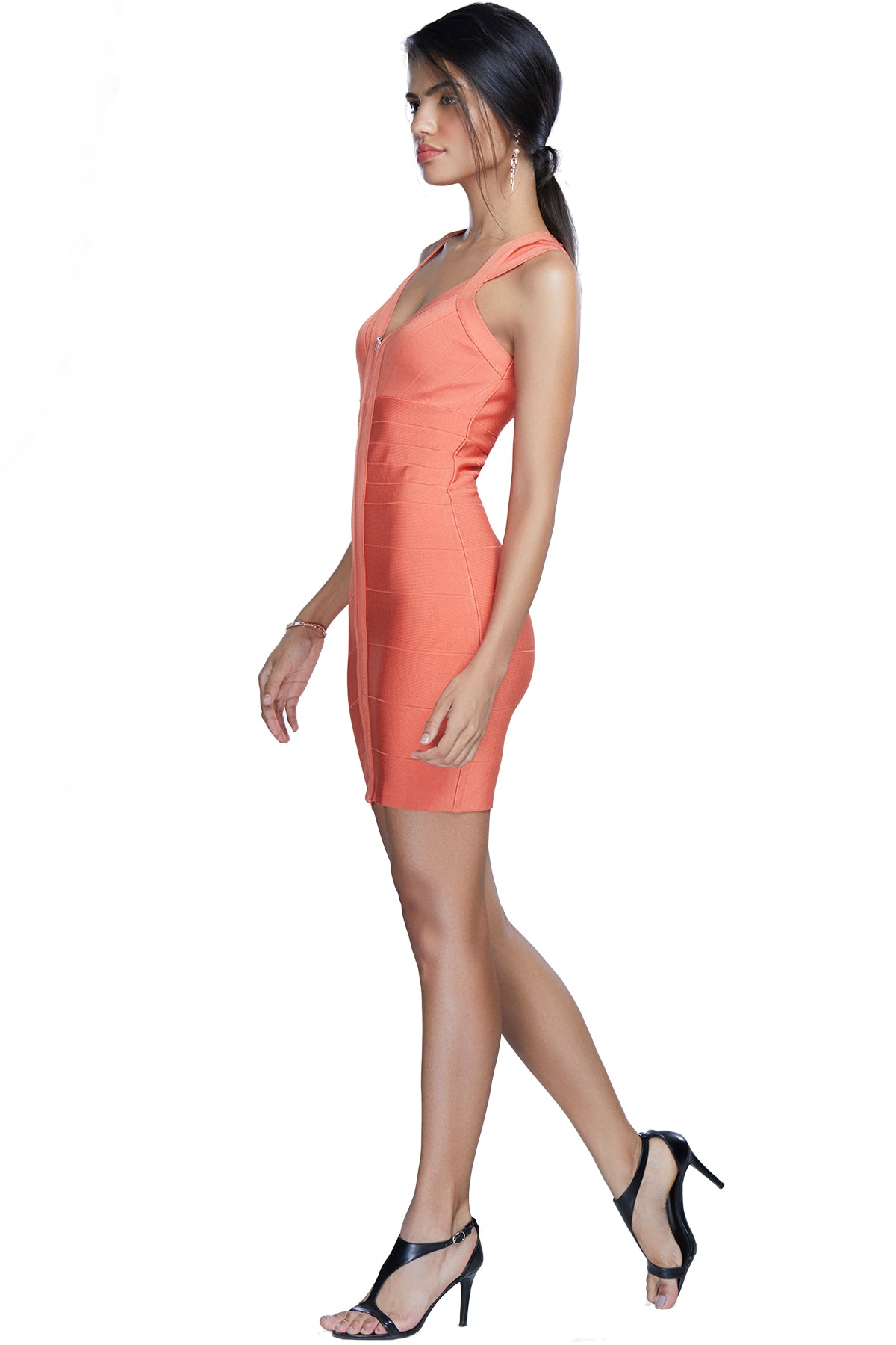 Seal the deal in this form-fitted peach bandage dress - flirty and fun as ever and with its fashion quotient topping the charts.