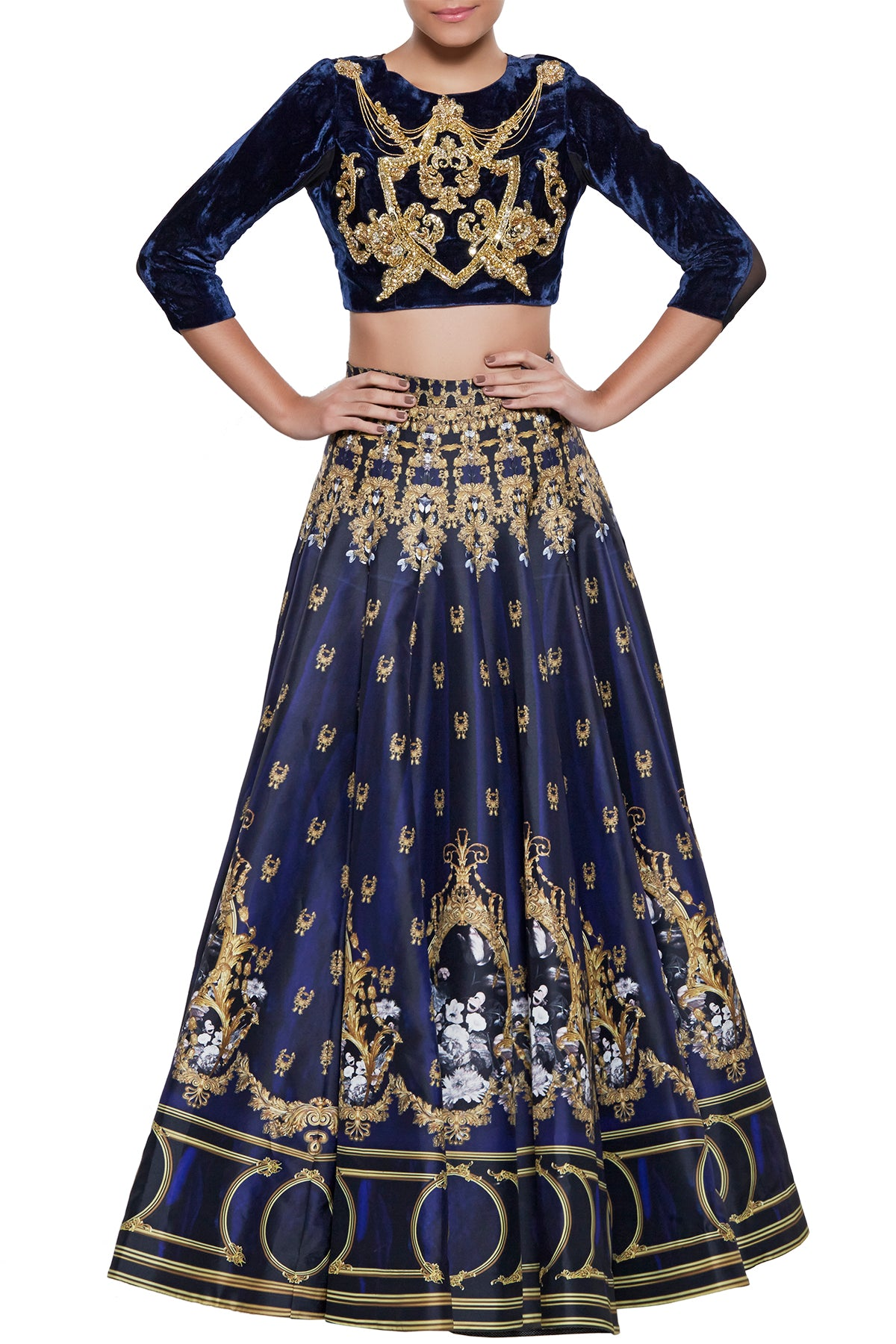 Cascading in silk with a class of the ages, our printed navy lehenga like a midnight dream is your best bet for the next big royal wedding. Its velvet and mesh crop top is a sheer masterpiece and keeps the outfit a step ahead of the season.