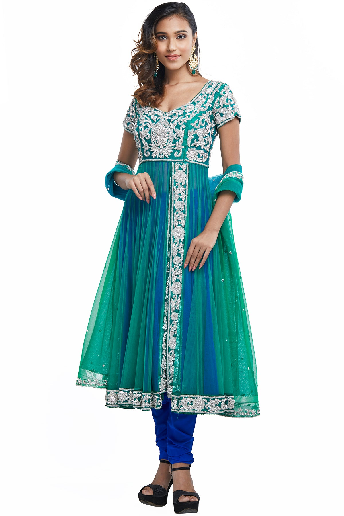 Why do boring when you can have twice the fashion in our double layered Anarkali tailored in the gorgeous silhouette of green & blue net. The zardosi embroidery and studded stonework make this fit for your every festivity.