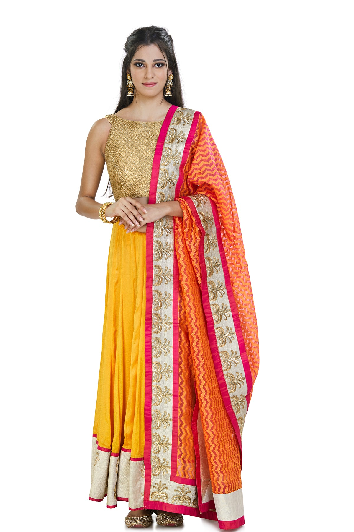 Vibrant & versatile, this saffron-colored silk, hand-embroidered skirt is complemented with a kardana embroidered fold blouse and pink chanderi dupatta.