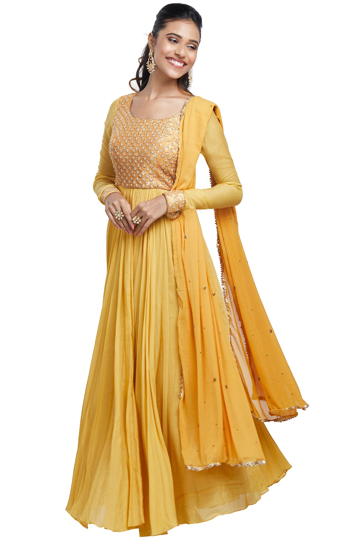 Have a fetish for sunshine and vibrant hues? Slip into our ochre yellow full-sleeved anarkali in chanderi finished with a sequin-embroidered bodice and georgette dupatta.