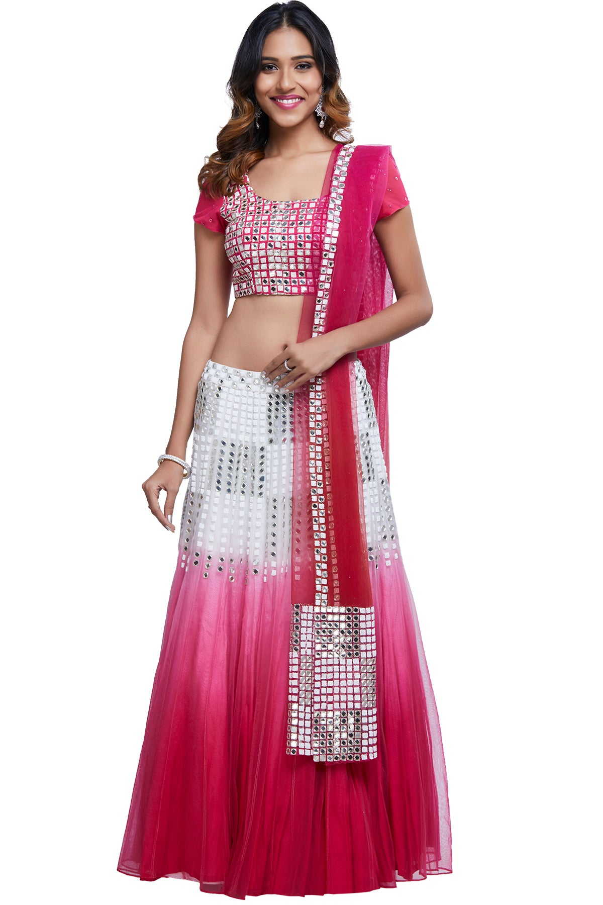 Mirror the magic of Indian rituals in this gushing romance of pink and white. This set is crafted in ombre net with beaded work and a mirror-bordered dupatta to add that extra layer of lust.