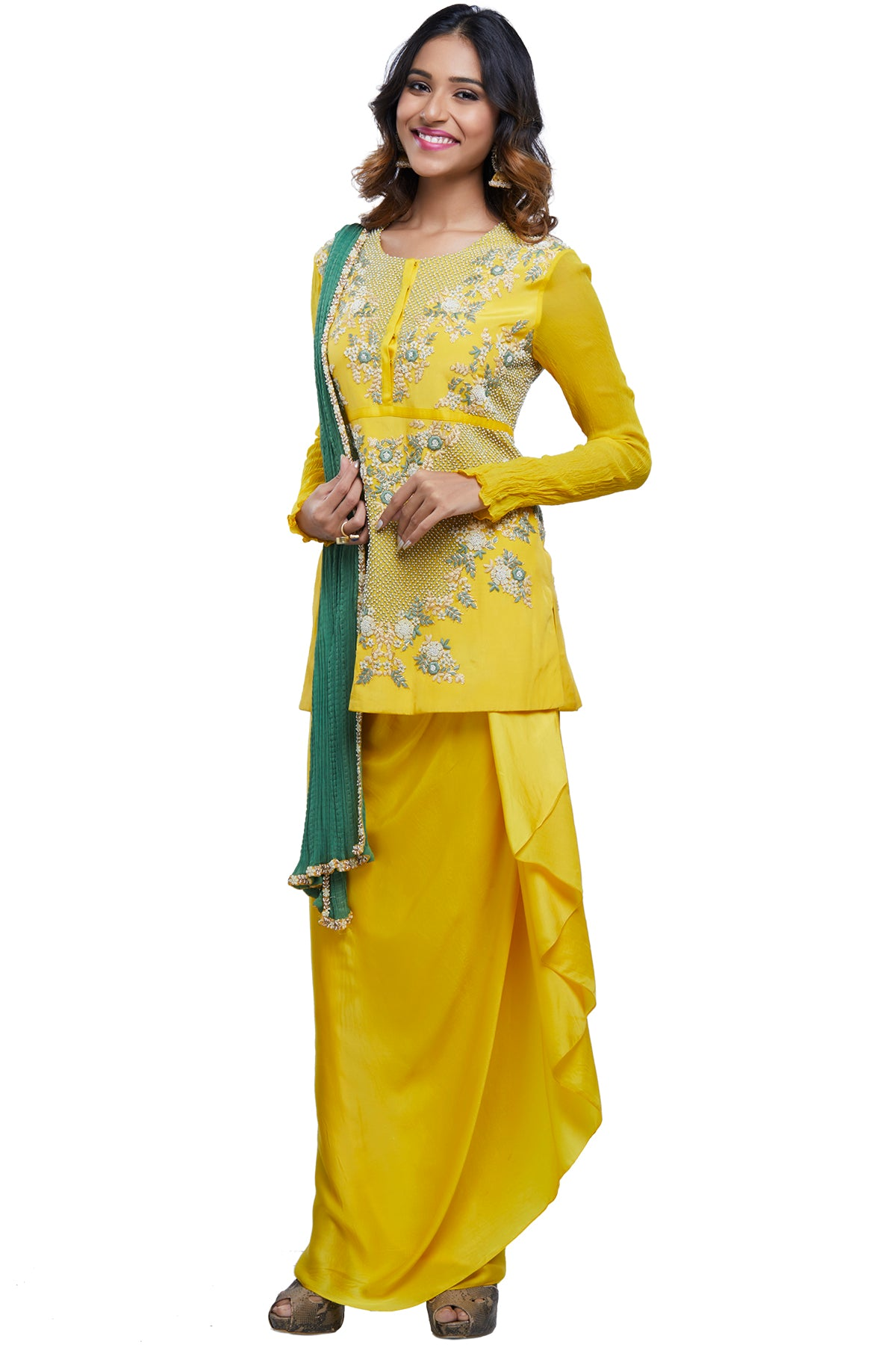 Speaking of sunshine, this raw yellow jhaal and pearl-embroidered short top is paired with a drape wrap skirt and embroidered crinkled georgette dupatta.