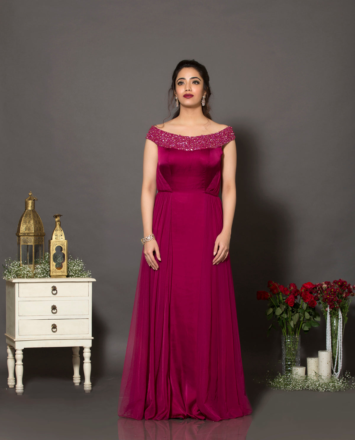 A beautiful satin georgette and soft net gown with the neckline highlighted using sequins and pearls.