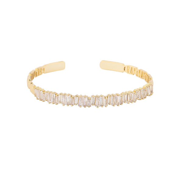 Nothing is more gorgeous than the sight of glittering gold. This heavenly line of pure baguette crystals are set in mixed metal alloy with a gold finish.