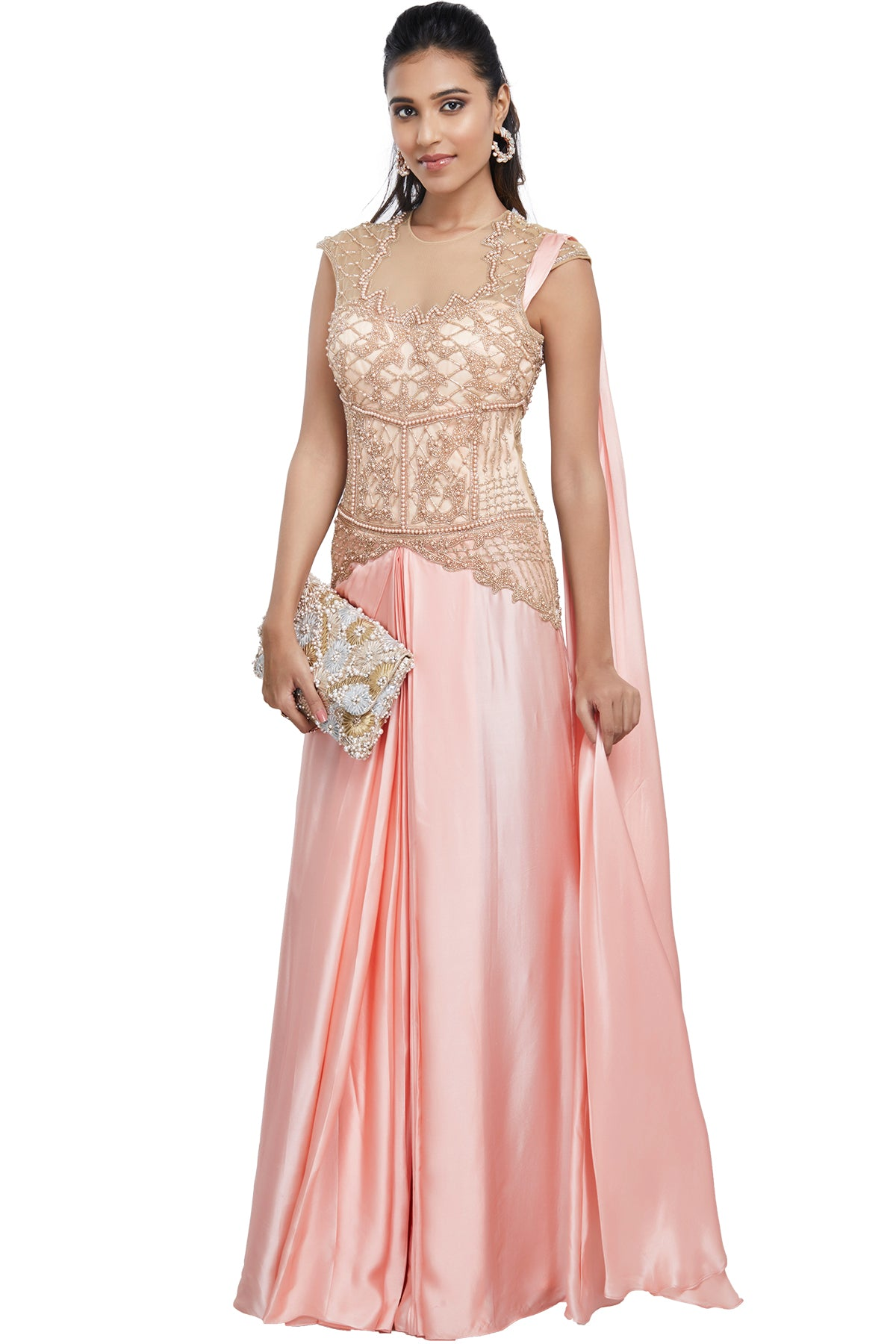 The epitome of east meets west, this baby pink soft net and cotton satin lehenga sari has a well-fitted, defining gold pearl & bead embroidered bodice. For your comfort, the outfit has a side zip and snap button closure on the shoulder.