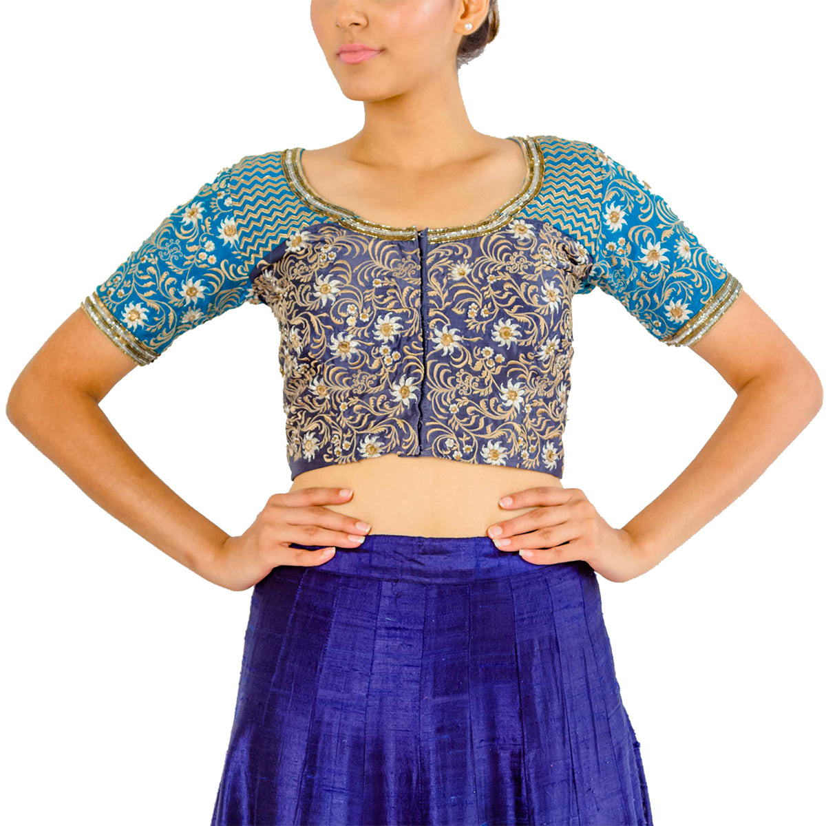 In the pretty myriad of the peacock - this light and dark blue silk patched choli is full of threadwork, zari and sequins embroidery.