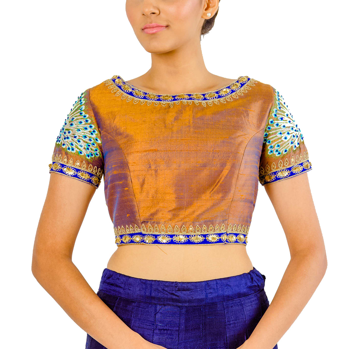 This piece brings back some serious pride and heritage with royal peacock motifs on the sleeves and back in a gold & blue two-toned silk material.