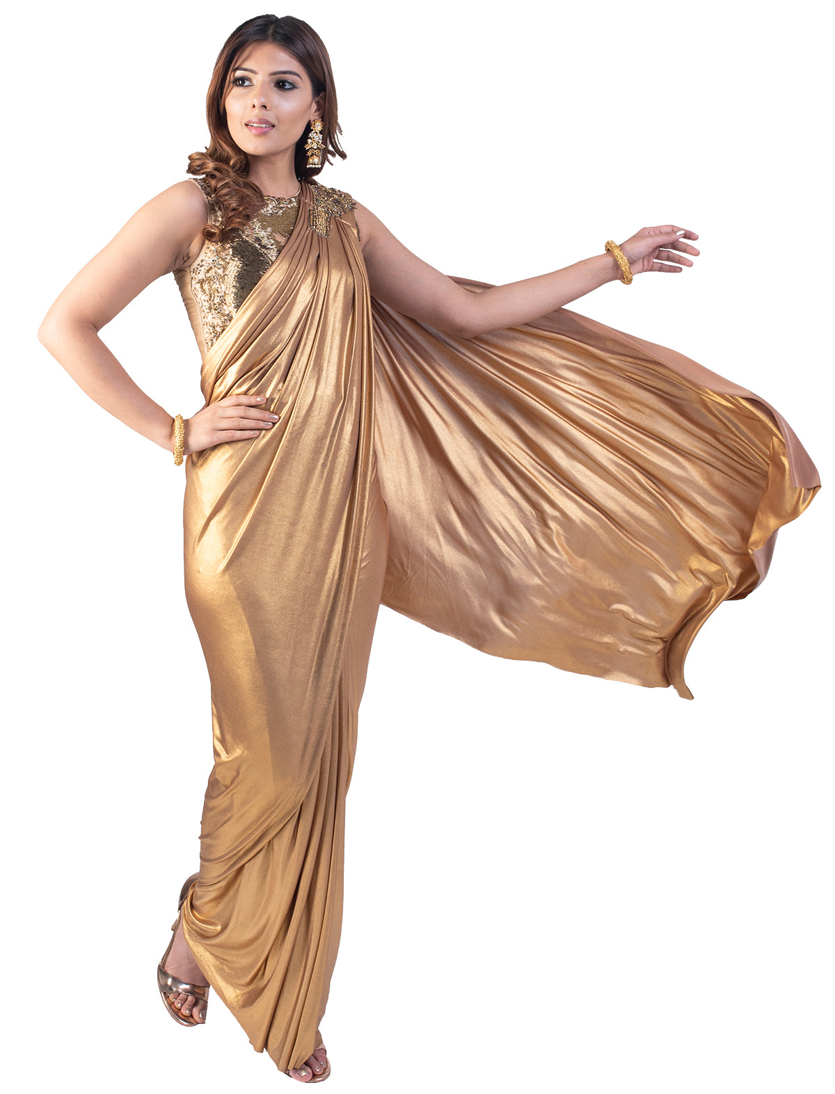 The gold over gold is an unusual mixture but still is unbelievably pleasing. The sleeveless blouse has shimmery look to it. The saree is an absolute art.