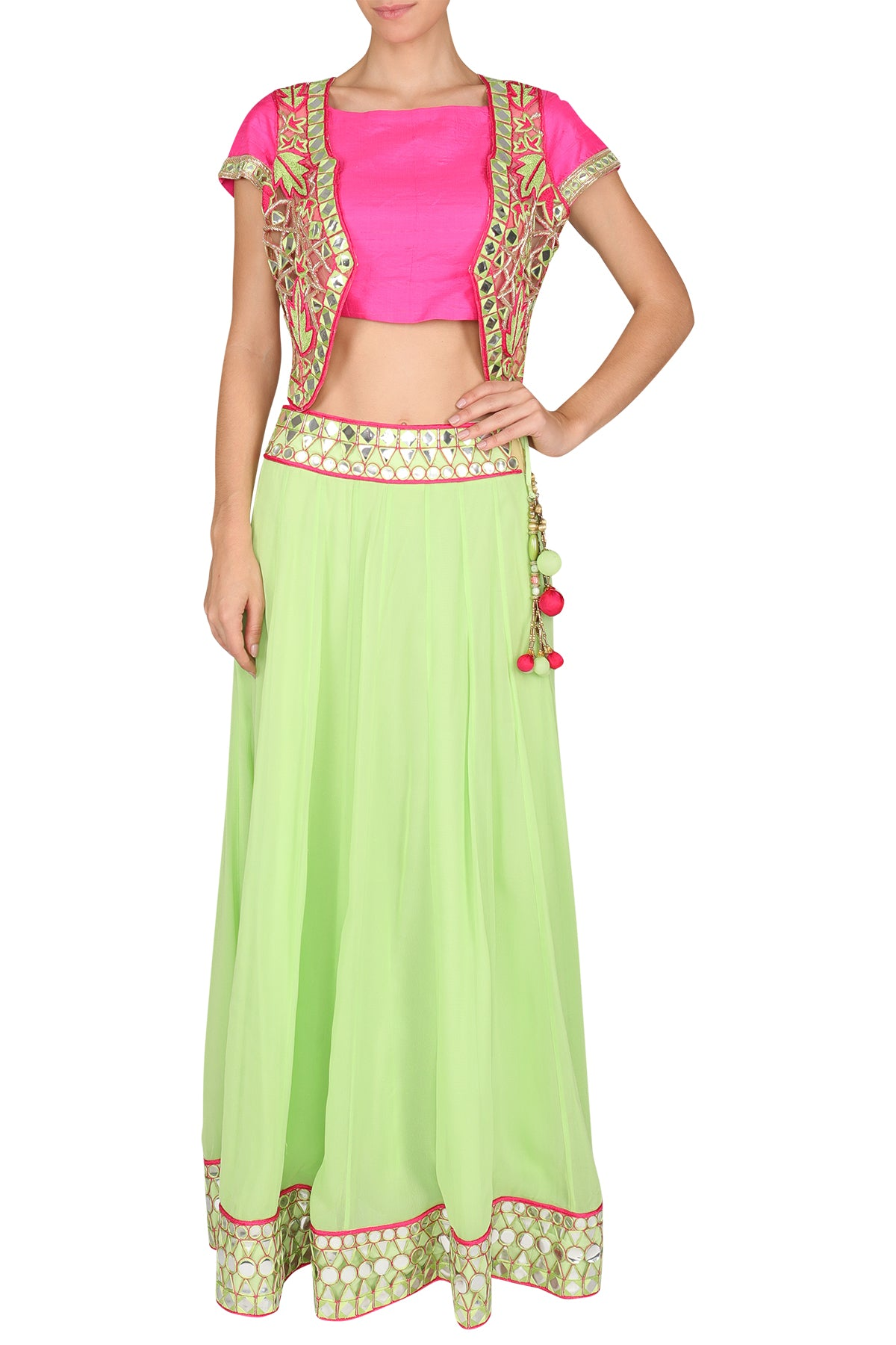 Painting a medley of moods all fashionable and festive - bring some life to your wardrobe with this parrot green mirror georgette lehenga, a plain pink silk blouse and a cutwork mirror embroidered short jacket.