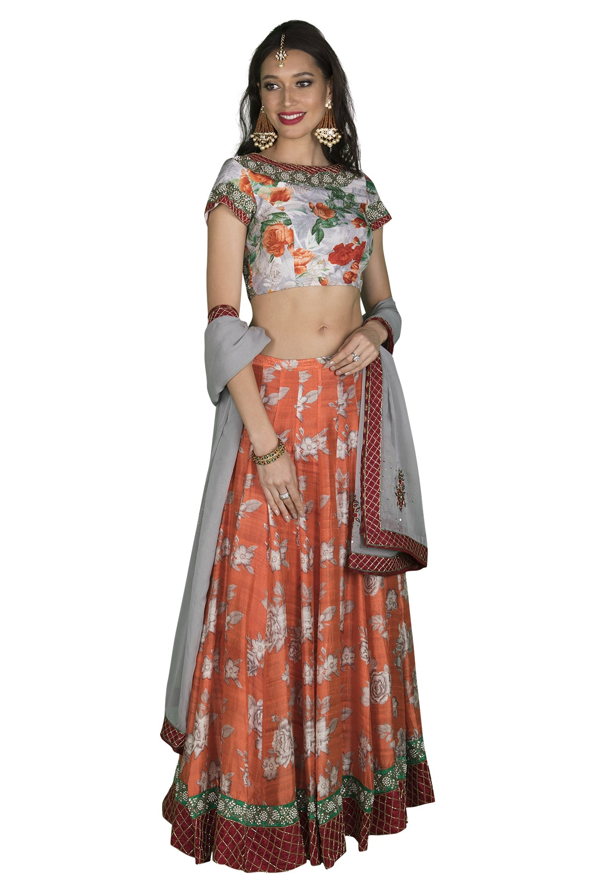 Grey blouse with pearl detailing and floral print. Orange skirt with red border.This outfit lets you stand out and gives you not only elegance but beauty as well.