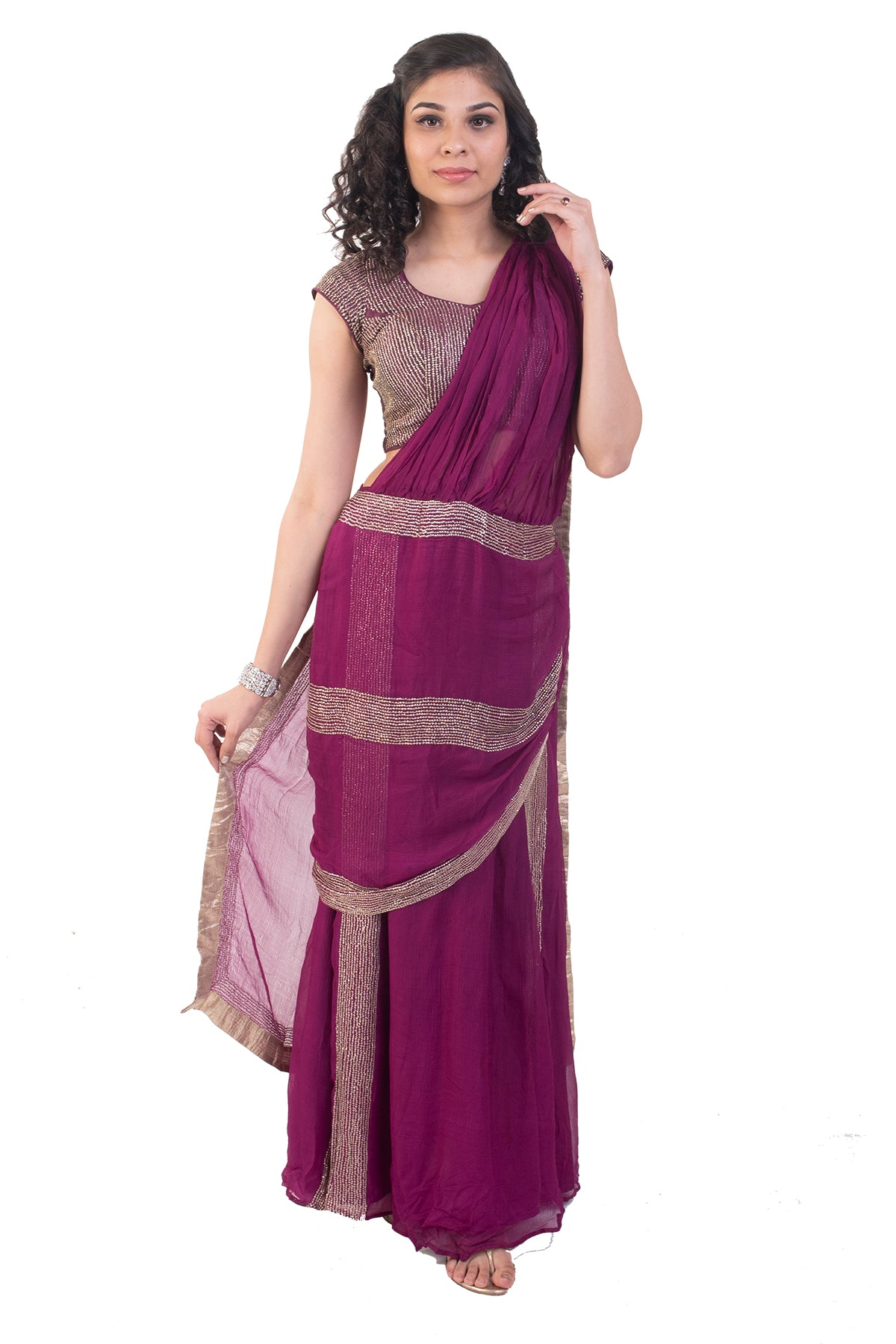 The shimmery look for this outfit shouts glam! The burgundy color and the unique pattern saree is perfect wear for your next event!