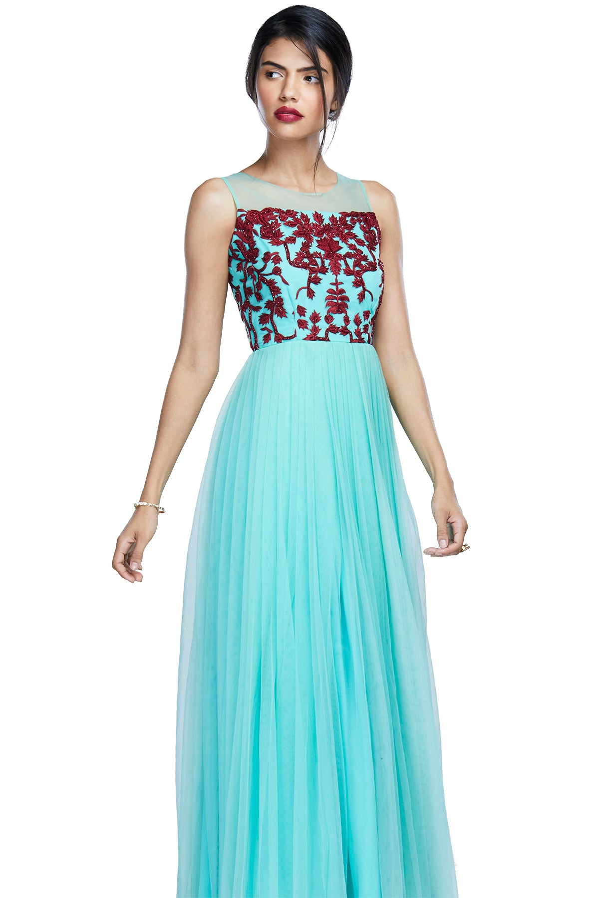 You're mint to stand out in this flouncy mint gown with a tinge of red embroidery to seal the deal. The outfit has a net bodice and plain tulle bottom.