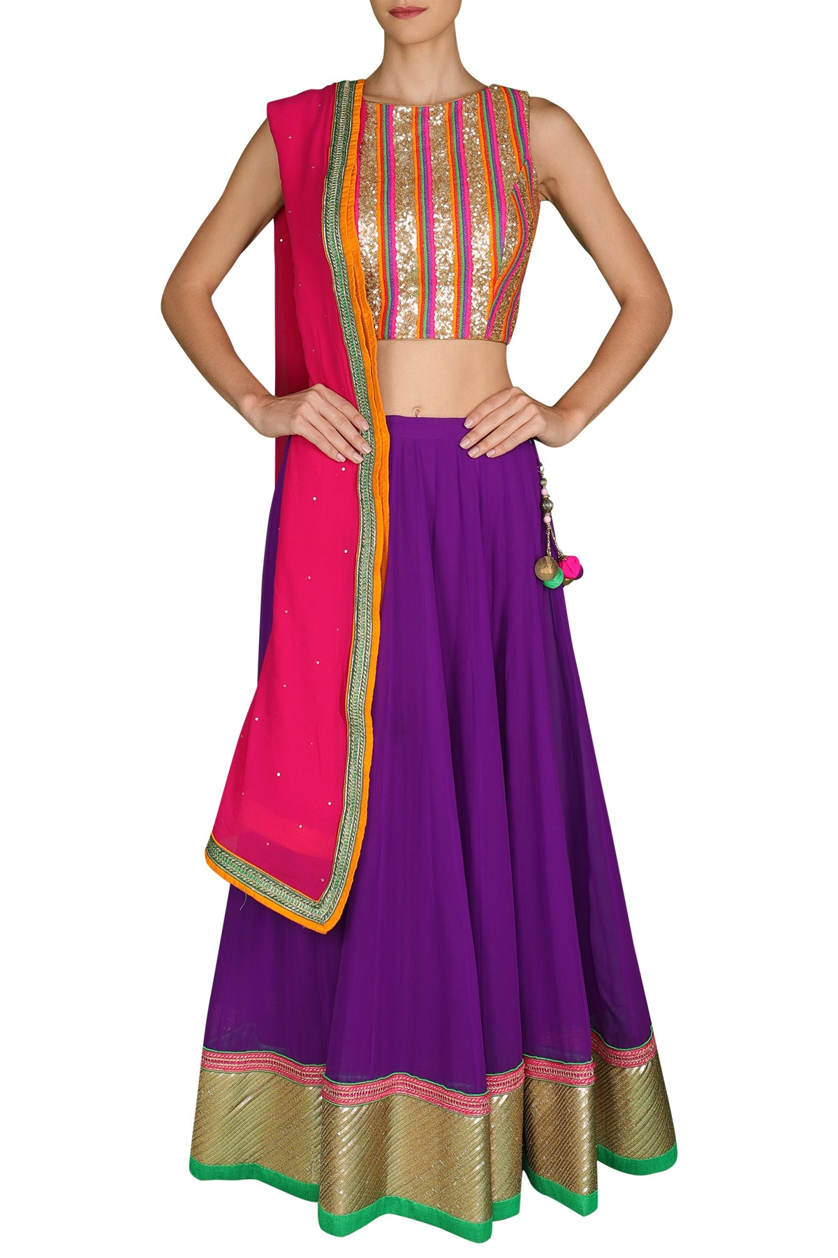 Lose yourself to the vibrant multi-colours of this vivacious wonder. Slip into its high neck sequin blouse with a futuristic feel and its purple georgette lehenga with a pink and orange shaded dupatta.