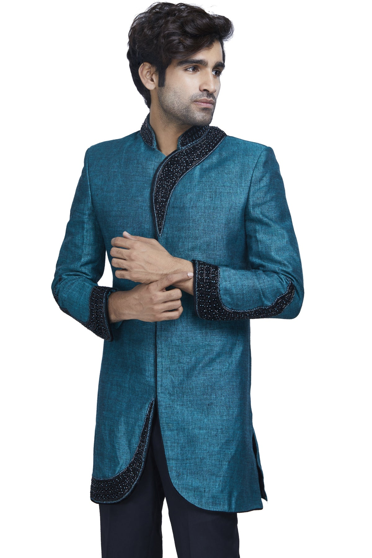 What are Indian festivities without a rush of royalty? Embrace regal hues with this peacock blue textured sherwani with asymmetrical black embroidery detailing on the neckline and cuffs.