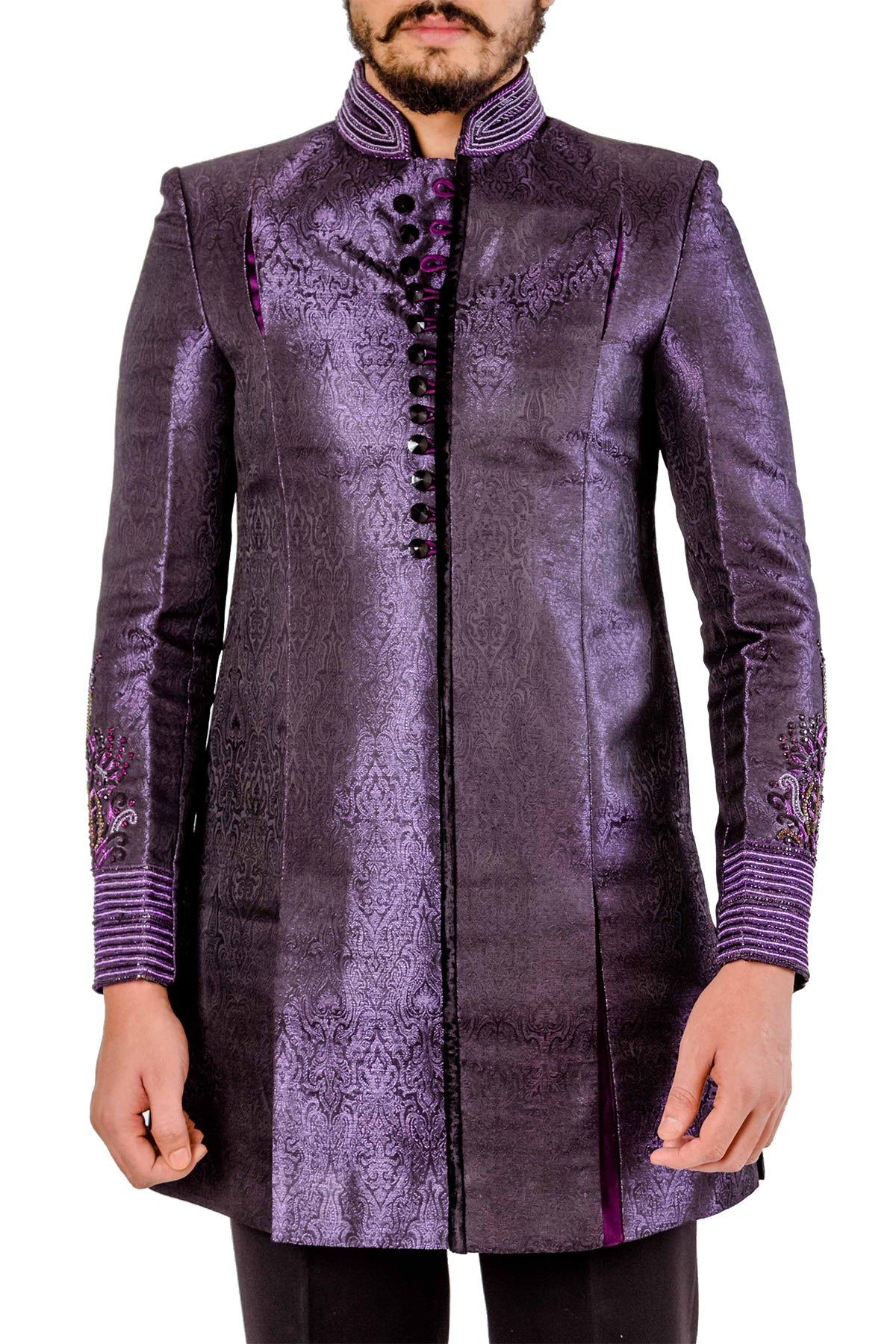 There's nothing more strapping than the sight of a man sporting royal colours in style. Get your hands on our purple jacquard fabric sherwani with embroidered cuffs and collar.