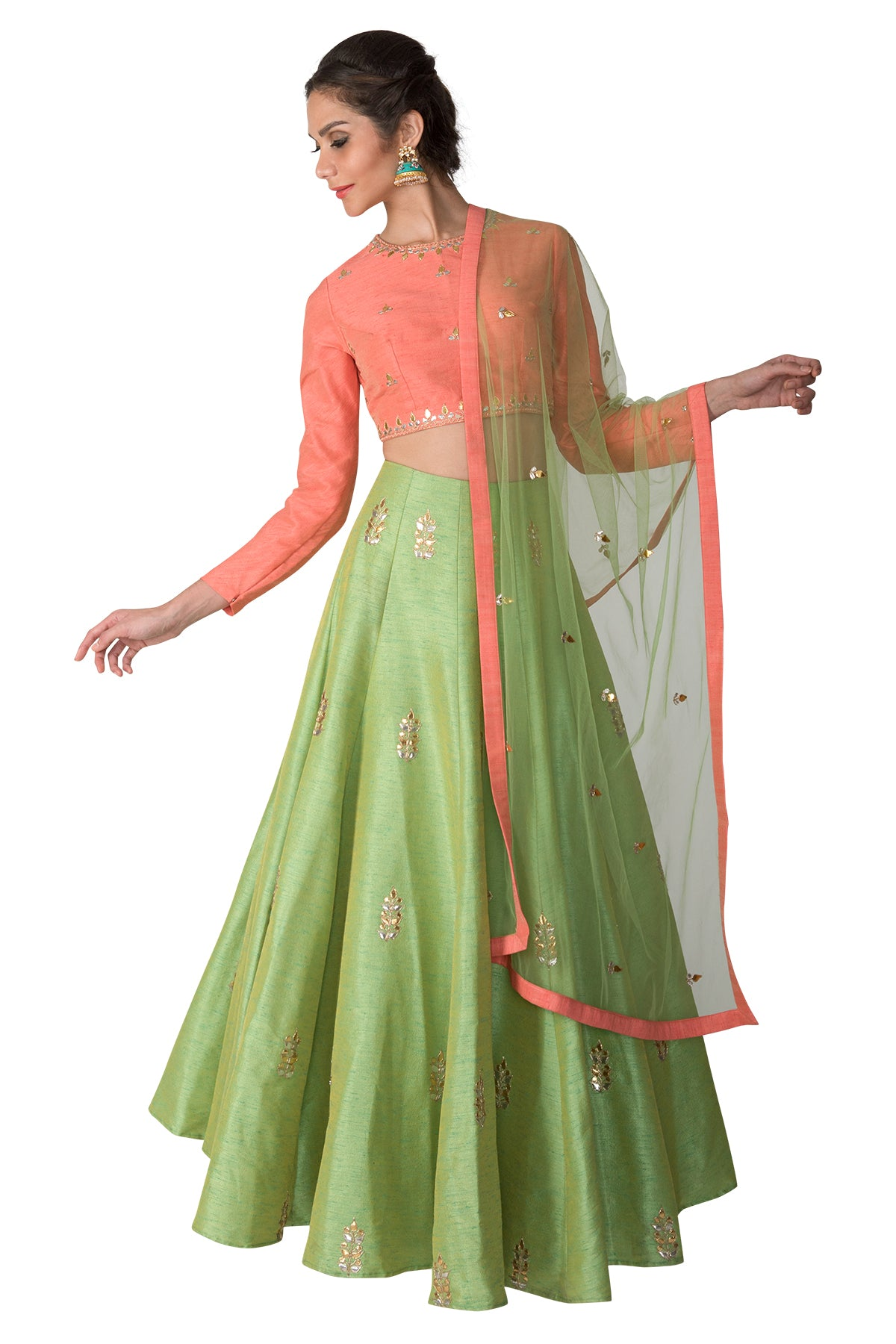 Let this outfit bring a whiff of that perfect pastel palette to your wedding wardrobe with its peach embroidered full-sleeve blouse, green gota lehenga & green net dupatta.