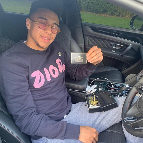 Jesse Lingard showing off his Car Cologne Diffusers