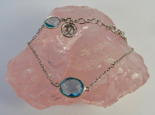 Blue Topaz and Silver Om Bracelet