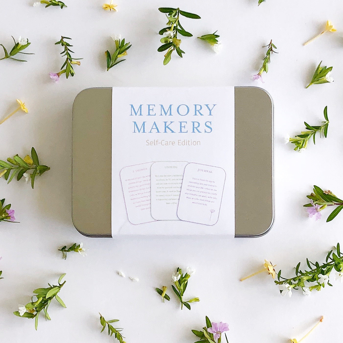 Memory Makers Self-Care Edition - 55 cards in an aluminium tin surrounded by tiny flowers