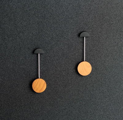 Round drop earrings by Rowena Sheen